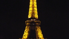 Eiffel Tower at night lit up in yellow lights
