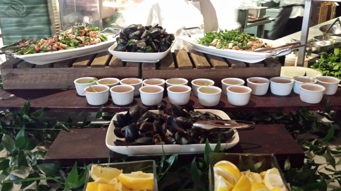 Seafood station, including ramekins of smoked salmon and cream cheese